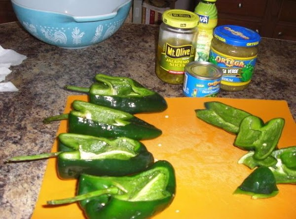 Wash and pat dry poblanos, slice off top part enough to make stuffing easy. Save...