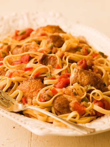 Pasta with Braised Chicken, Sausages, Peppers & Tomatoes