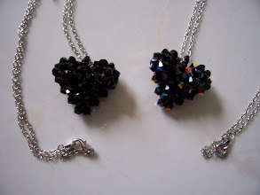 "Photo: Swarovski Crystal Heart. Size: 1"" x 1"" face and 1/2"" thick with 18"" chain. Color left to right: Jet (black), Jet AB. $35.00 each."