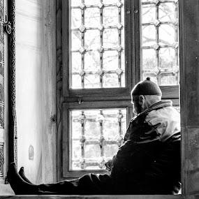 The man in the window by Eko Madiasto - Black & White Street & Candid