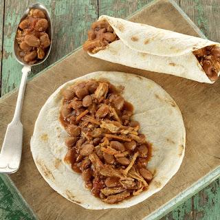 Bush's® Slow Cooker Pork and Pinto Bean Enchiladas