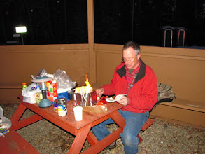 Photo: Ted and the white gas stove in the camping shelter whipping up dinner