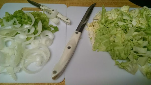 Prepare the celery, onion and cabbage.
