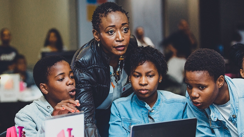 A mentor is pictured with the girls who participated at last year's AI in Soweto bootcamp. (Photo source: Kgalema Motlanthe Foundation)