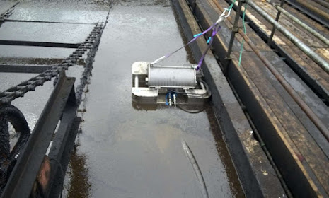 Skimmers for daf sludge oil recovery in a canal