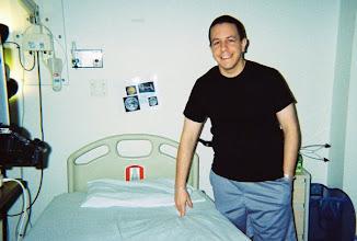 Photo: Scott moving into his new room in the NASA ward at UTMB