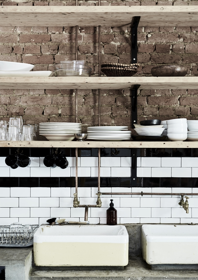 The copper piping and lab sinks in the kitchen were sourced from a local demolition yard.