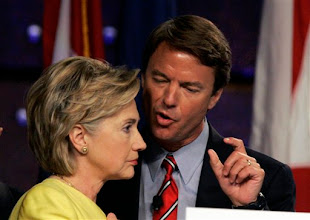 Photo: Democratic presidential hopefuls Sen. Hillary Rodham Clinton and Sen. John Edwards talk after participating in a forum at the NAACP convention in Detroit, Thursday, July 12, 2007. (AP Photo/Carlos Osorio)