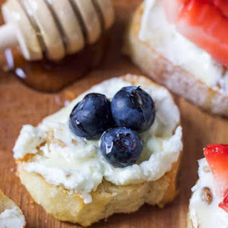 Goat Cheese, Fruit, Walnut and Honey Crostini
