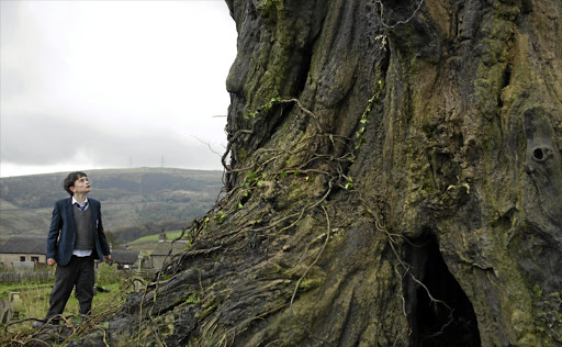 Lewis MacDougall plays Conor, who communicates with an earth spirit in an ancient tree, in 'A Monster Calls'.