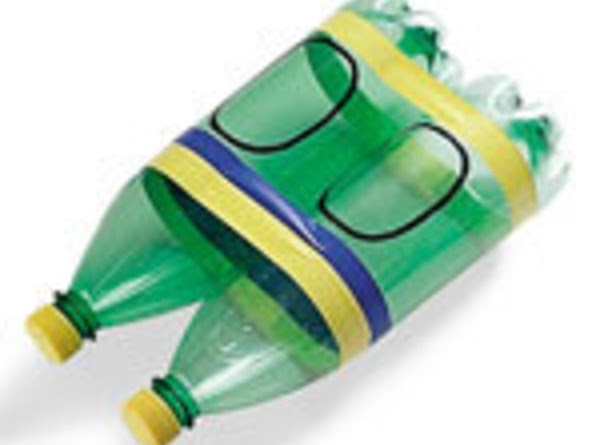 Remove the labels from the plastic bottlesClamp the bottles together temporarily with the rubber...