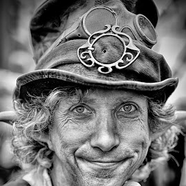 Scalawag by Marco Bertamé - Black & White Portraits & People ( scalawag, glasses, fist, portrait, smiling, man, hat )