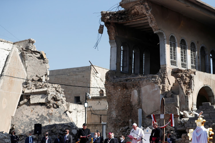 Pope Francis prays for war victims at 'Hosh al-Bieaa', Church Square, in Mosul's old city, Iraq, on March 7, 2021.