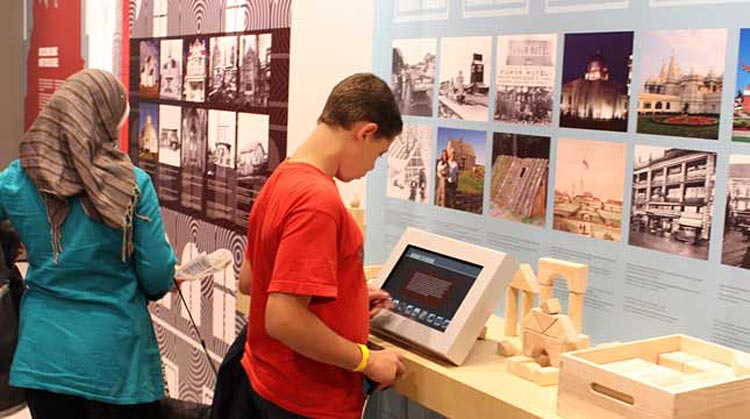 A boy checks out a terminal at the Canadian Immigration Story exhibit at the Canadian Museum of Immigration.
