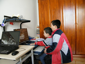 Photo: baby played pc game with his cousin.