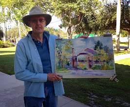 Photo: Tom Ryan with his artworkat Old School Square 12-19-13