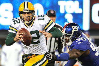 Photo: New York Giants defensive end Jason Pierre-Paul chases Green Bay Packers quarterback Aaron Rodgers during the first half of Sunday night's game. Photo by Robert Deutsch, USA TODAY.