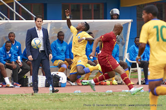 Photo: Michel RUSEHESANGOGA (2) is fouled by Andre Ayew (10) [Rwanda Vs Ghana AFCON2017 Qualifier, 5 Sep 2015 in Kigali, Rwanda.  Photo © Darren McKinstry 2015