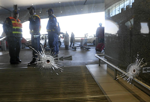 SHATTERED   Bullet holes in the sliding doors at the departure terminal of Cape Town International Airport  where the shooting took place early on  Wednesday morning Picture: Esa Alexander
