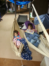 Photo: I rigged up a pair of bedsheet hammocks for the girls, tied off the treadmill. They enjoyed it OK. Not a fan of the hammock yet. Practicing camping with them so they do better when we go for real.