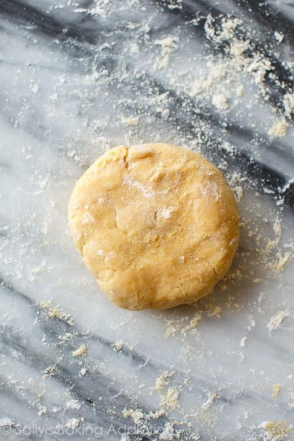 Make the crust: Whisk the flour, cornmeal, sugar, and salt together in a medium...