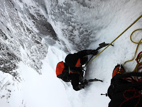 """Photo: Dragging myself up one of the awesome vertical ice pitches of """"Point Five Gully"""", V, on Ben Nevis."""