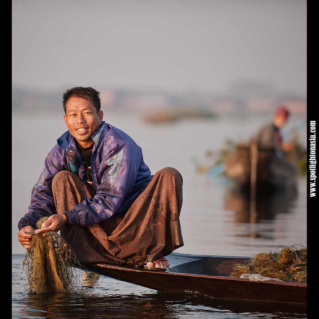 Photo: A fisherman on Inle Lake checks his net early morning.