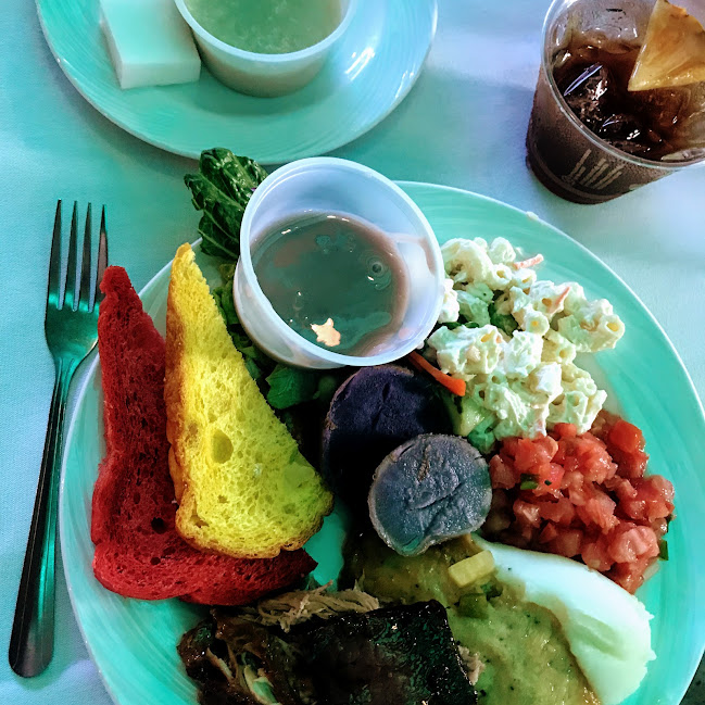 Kalua roasted pig, poi, lomi salmon, sweet & sour mahimahi, macaroni salad, guava and pineapple breads, coconut rice pudding, mai tai, and more from the dinner buffet at Smith Family Garden Luau