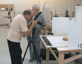 Photo: Gallery photographer, Michael Colella, shoots a hollow form by Eliot Feldman as Stuart Glickman looks on.