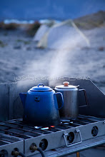 """Photo: Coffee and hot water being brewed while on a raft trip down the Tashenshini River. The """"Tat"""" flows out of Yukon, CA, through British Columbia and empties into Glacier Bay National Park in Alaska, US."""