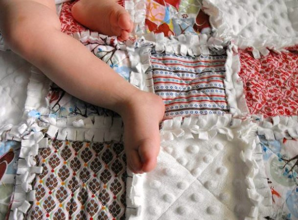 Baby Laying on a Rag Quilt