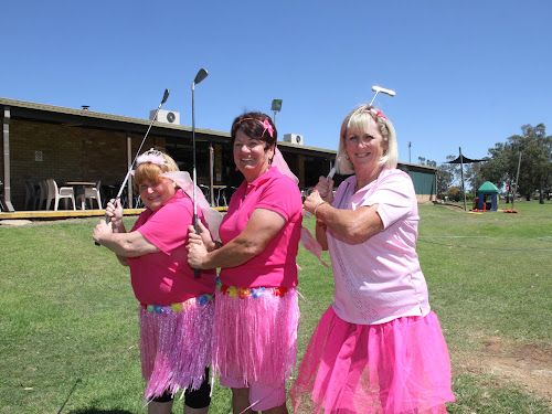 Golfers Loretta Bell, Lynn Shearer and Peggy Penberthy practise their swings for Sunday's charity golf day in aid of the McGrath Foundation.