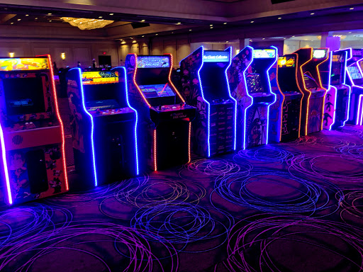 80's themed video game event created for a corporate meeting. By Dzign is the source for all your event planning needs! Printing, Floral, Design, Planning, custom decor, Rentals, linen, furniture, games and everything else you need to wow your guests.