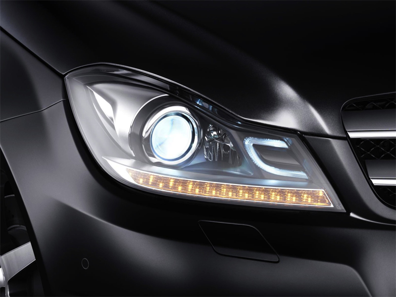 Photo: Available on every C-Class are bi-xenon headlights, their brighter, whiter light delivering greater visibility than halogen lights. And if you look closely, you'll even see a subtle nod to the C-Class itself.