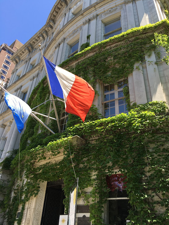 The French and EU flags fly outside of the Payne Whitney Mansion.