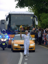 Photo: Olympic flame runner on Mill Road - Cambridge 2012