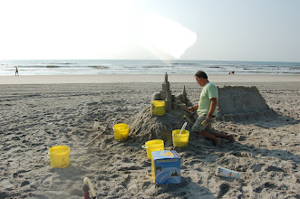 Photo: Building sand castles for a living...tough job but someone has got to do it!