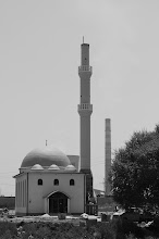 Photo: mosque in Plemetina - by the end of our stay it also got a nice top which distinguishes it more clearly from the power plant chimney