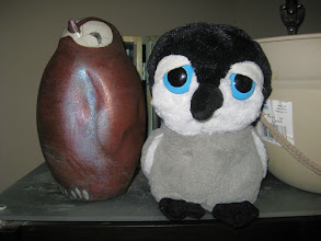 Photo: Carlisle poses with a ceramic penguin that came home with us from the downtown Tampa Art show.