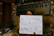A protest was held outside Parktown Boys' High on Tuesday. On the same day, Enoch Mpianzi's parents and a SAHRC delegation visited the North West lodge where Enoch died.