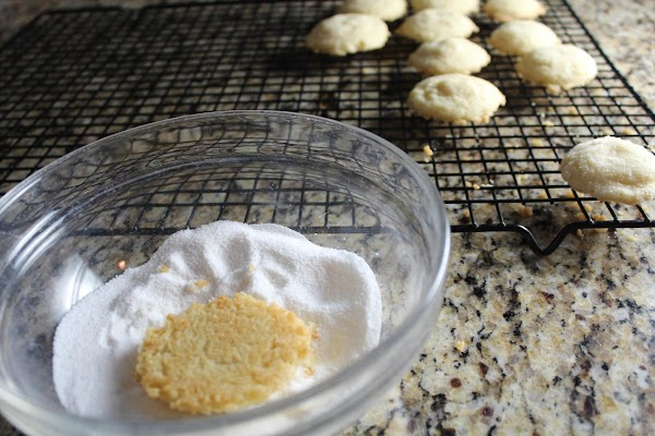 Roll slightly warm cookies in sugar mixture and return to cooling rack. After tea...