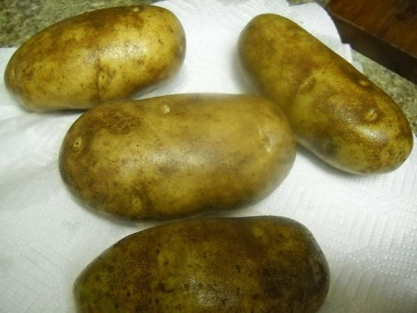 With a vegetable brush rinse and scrub down 4 russet potatoes. Set on a...