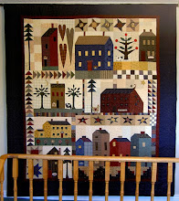 "Photo: This is Trisha's quilt from the pattern 'House Sampler"" by Country Quilts.   It was a block of the month project and one of my favorites and hangs in the hallway of my house."
