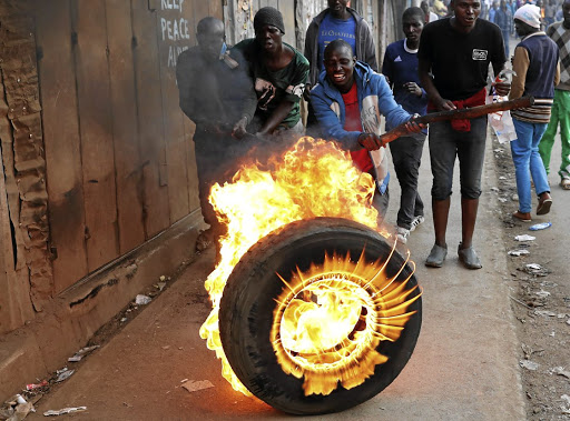 Supporters of Kenyan opposition leader Raila Odinga set up a barricade of flaming tyres in Kibera, Nairobi, on August 9 2017, a day after the country voted. Picture: REUTERS
