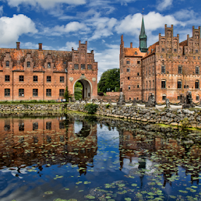 Egeskov Castle by Gianluca Presto - Buildings & Architecture Homes ( home, nobody, old, reflection, water reflection, europe, reflections, architecture, house, historic, ancient, tale, dark, cloudy, bricks, water, clouds, building, hdr, romantic, egeskov, lake, quiet, history, tower, castle, bridge, historical,  )
