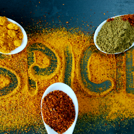 Spice text with spice powders. by Dipali S - Food & Drink Ingredients ( cayenne, aroma, cuisine, herbs, spice, ground, powder, pepper, yellow, spices, close, seasoning, paprika, allspice, ingredient, pile, closeup, isolated, dry, texture, spicy, white, culinary, kitchen, curry, chili, up, organic, red, herb, food, background, turmeric, flavoring )