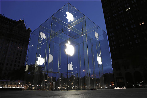 TRANSPARENT BUSINESS: A view at daybreak of the illuminated entrance to the Apple 24-hour store - at 767 5th Avenue between 58th and 59th Streets - designed by Bohlin Cywinski Jackson, in  Manhattan, New York Picture: GETTY IMAGES