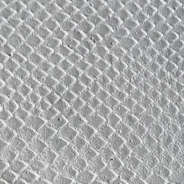 Béton blanc motif croco