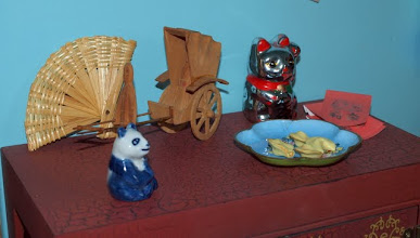 Photo: Another wooden carving and a lucky cat from an import store.    And fortune cookies!