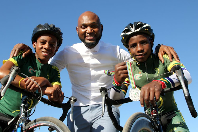 Imveli Cycling Academy members, from left, Simiselo Nelani, 16, founder Lukholo Badi and Zukhanye Mahashe, 14, will be travelling to Europe in September to learn more about its cycling culture Rovers snatch crucial victory